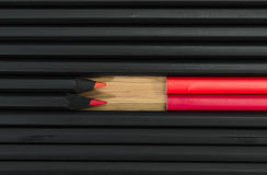Red color in black pencils Stock Photo