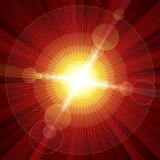Red color burst of light with lens flare Stock Photo