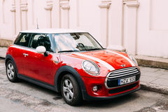 Red Color Car With White Stripes Mini Cooper Parked On Street In Royalty Free Stock Photos