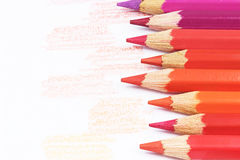 Red color crayons and drawn red samples Royalty Free Stock Photo