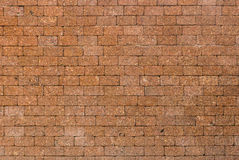 Red color of decorative laterite stone wall surface Royalty Free Stock Photos