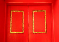 Red color door. The old red color wooden temple door represent the temple decoration and construction concept related idea Stock Image