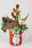 Red color gift cup with candy for new year celebration. Vertical image with  holiday decorated red cup in the white background. The cup has image of Snowman. On Stock Photo