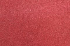 Red grainy paper background texture. Red color grainy paper background texture Royalty Free Stock Photos