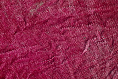 Red color grungy textile texture. Stock Photography