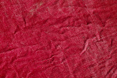 Red color grungy textile texture. Royalty Free Stock Images