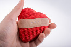 Red color heart  shaped object in hand Royalty Free Stock Images