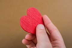 Red color heart shaped object in hand royalty free stock image