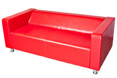 Red color imitation leather office couch, isolated on white. Royalty Free Stock Images