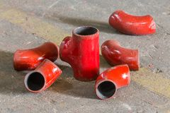 Red color iron pipe joint Stock Image