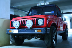 Red Color Jeep with Fog Lights. Automobile photograph of a red color maruti gypsy jeep with fog lights Royalty Free Stock Photos