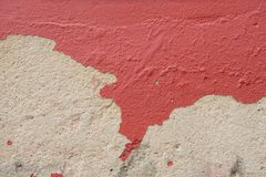 Red color painted on cement wall are peeling stock photography