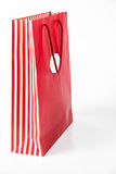 Red  color paper bags isolated on white. Stock Photos