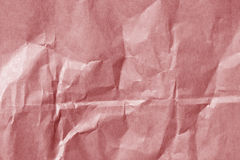 Red color paper sheet surface with wrinckles. Royalty Free Stock Images