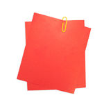 Red color papers and paper clip Royalty Free Stock Image