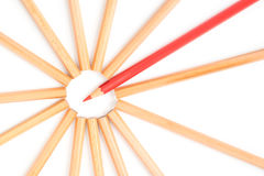 Red color pencil stands out of the brown pencils Royalty Free Stock Photo
