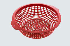 Red color plastic basket on white background Royalty Free Stock Images