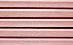 Red color plastic panel wall pattern. Stock Photos