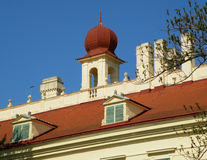 Red color rooftop decoration against vivid blue sky, Austria Royalty Free Stock Photography