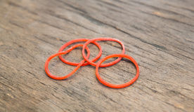 Red color rubber band Stock Photos