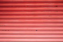 Red color shutter door. Background stock photos