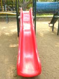 Red color slide at children`s playground. Red color slide at playground for children royalty free stock image