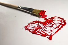 Red color splash heart and brush Stock Photography