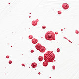 Red Color splatter on white Stock Photos