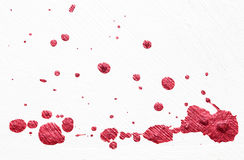 Red Color splatter on white Royalty Free Stock Photography