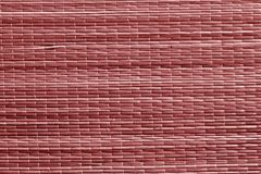 Red color straw mat surface. Stock Photos