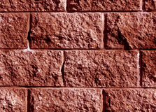 Red color stylized brick wall pattern. Stock Photos