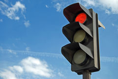 Red color on the traffic light. With a beautiful blue sky in background Royalty Free Stock Photography
