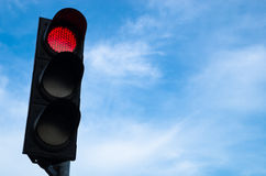 Red color on the traffic light. With a beautiful blue sky in background Royalty Free Stock Photo