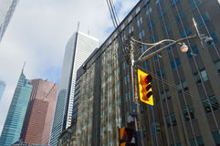 Red color on the traffic light in Toronto downtown. Royalty Free Stock Image