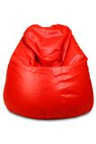 Red colored bean bag isolated. On white background stock photos