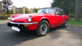 Red colored british six-cylinder sports car Triumph TR6 Stock Image