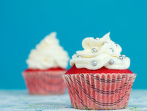 Red colored cupcake with beautiful decorations Royalty Free Stock Images