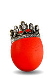Red colored egg with golden crown isolated Stock Image