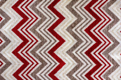 Red colored fabric with zig zag pattern Stock Photo