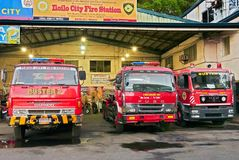 Red colored fire trucks inside the Iloilo fire station stock photo