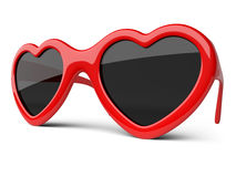 Red colored glasses in a form heart. Happiness and love concept. Royalty Free Stock Images
