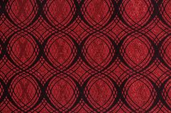 Red colored patterned fabric texture. Details of the texture and weaving of red fabric stock photography