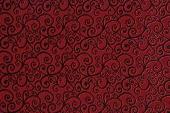 Red colored patterned fabric texture. Details of the texture and weaving of red fabric royalty free stock image