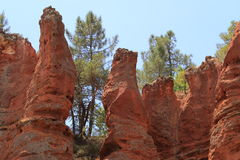 Red colored peaks landscape near Roussillon, France Stock Images
