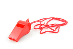 Red colored plastic whistle Stock Images