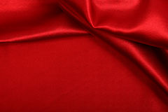 Red colored satin fabric background Royalty Free Stock Photos