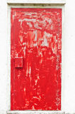Red colored weathered door Stock Photos