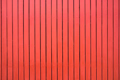 Red colored wood fence texture background Stock Photography