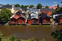 Red-colored wooden buildings on the riverside in Porvoo, Finland Royalty Free Stock Images