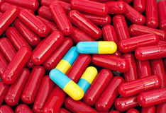 Red colorful capsules Stock Photos